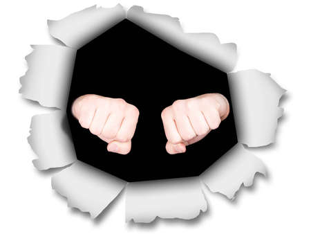 A photograph of two fists punching through some paper. photo