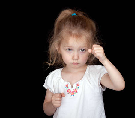 A photograph of a cute but sad child that could be holding something. Stock Photo - 9602883
