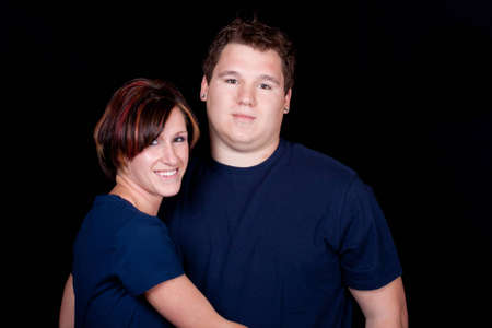 An isolated image of a young man and woman cople.  They are wearing blank t shirts so any text can be entered by the buyer. Standard-Bild - 9748343