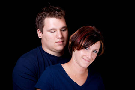 An isolated image of a young man and woman cople.  They are wearing blank t shirts so any text can be entered by the buyer. photo