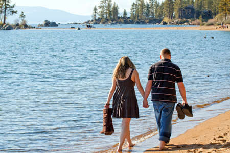 A romantic image of a cute couple on the beach in Lake Tahoe.