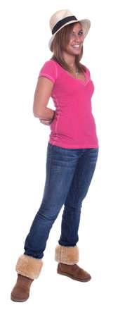 Full body isolation of a hispanic girl wearing a hat.