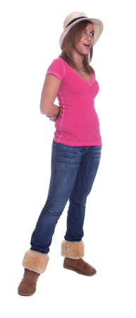 Full body isolation of a hispanic girl wearing a hat and talking.