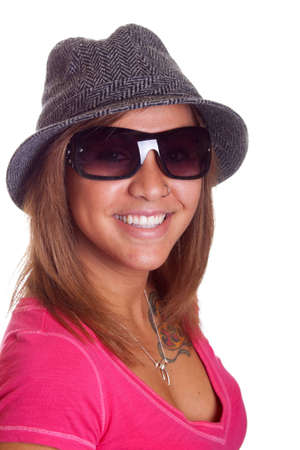 Isolated image of a hispanic girl wearing a hat and sunglasses. Standard-Bild