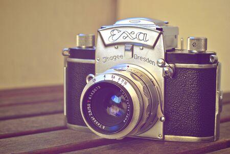 analog camera: Old vintage analog camera on wooden desk