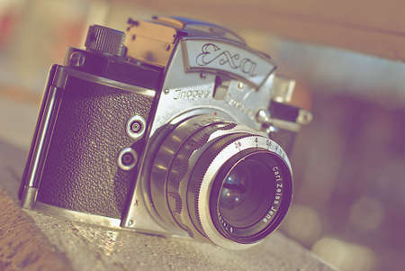 analog camera: Old vintage analog camera on white desk