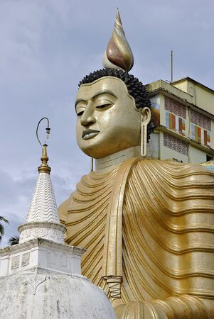 buddha sri lanka: Biggest sitting buddha with pagoda in Sri Lanka Stock Photo