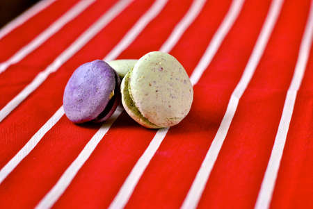 maccheroni: Three macarons on red and white striped tablecloth