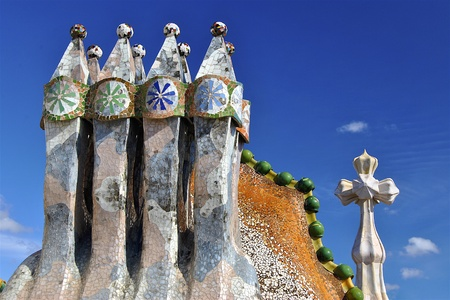 turrets: Mosiac chimneys and cross with mosaic domed roof of Casa Batllo