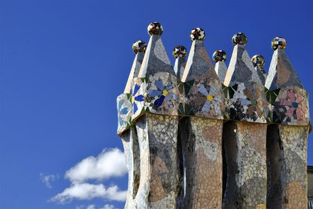 turrets: Mosaic chimneys on modern roof of Casa Batllo with blue sky