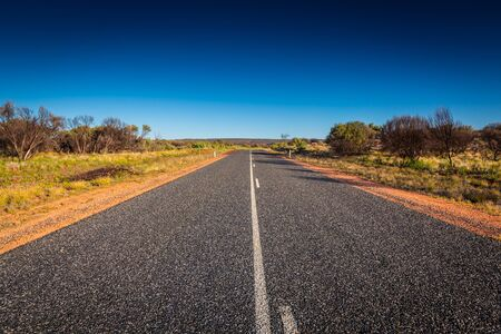 tjuta: Australias outback road and landscape view in northern territory.