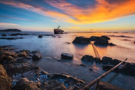 ship wreck: Natural seascape view with wreck ship at sunset