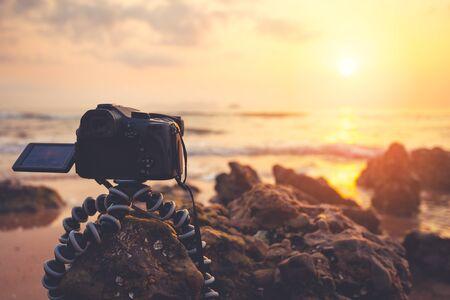 capturing: DSLR Camera capturing sunrise of beach view.
