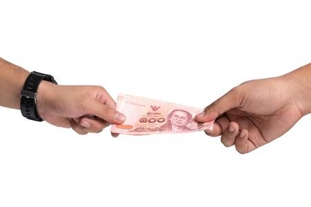 remuneraciÓn: Corrupción. Dando un soborno. Dinero en la mano. Foto de archivo