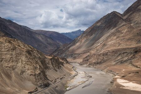 confluence: Confluence of Indus and Zanskar Rivers in Himalayas. Indus valley, Ladakh, India
