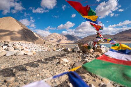 Colorful prayer flags with motion at Pangong Lake, Ladakh, India Stock Photo - 79539085