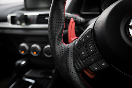 paddle wheel: Control buttons on steering wheel in a modern car