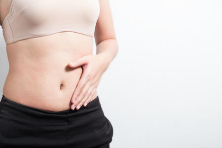 Female hand protects stomach, Pregnant concept Stock Photo