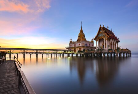 Wat Hong Thong (golden swan), a Thai temple that is built into the sea. At Chachoengsao, Thailand.