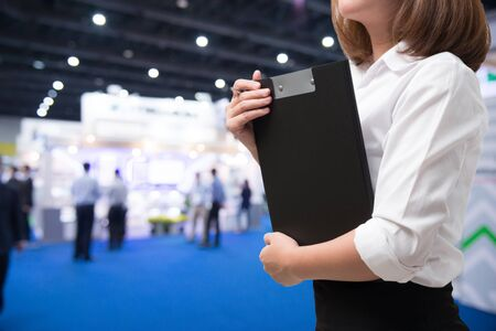 Business woman in exhibition event