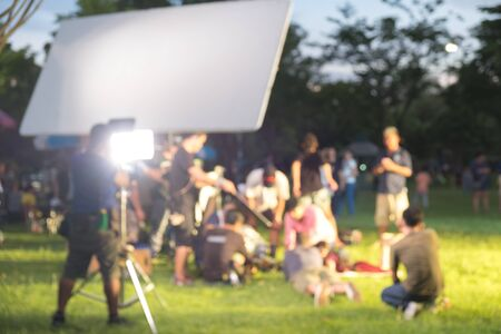 Blurred Busy outdoor filming production crew team Stock Photo