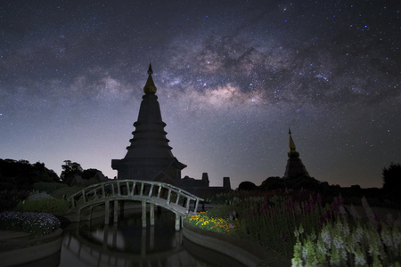 Milky way against Pagoda on Inthanon hill in Chiangmai, Thailand