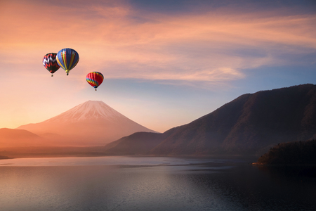 Hot air balloon flying on Motosu lake with Mt.Fuji in background