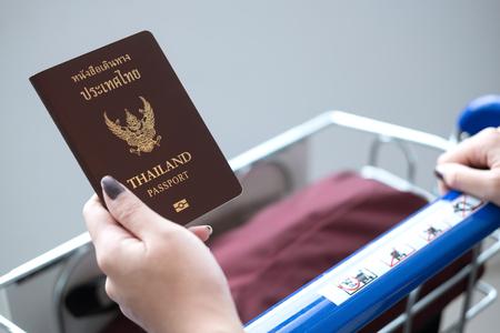 Thai passport on traveler hand