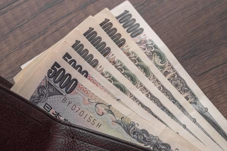 Japanese yen bank notes in wallet Фото со стока