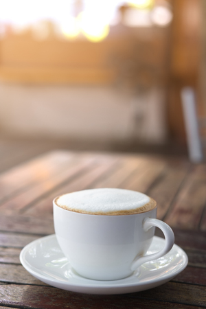 Hot coffee cup on table