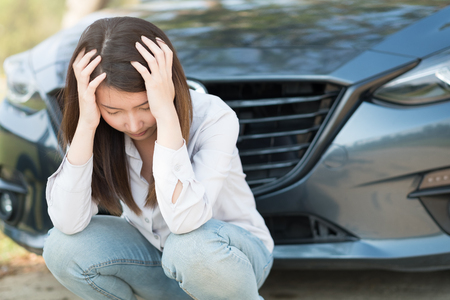 Young woman feel sad because of her car broken down
