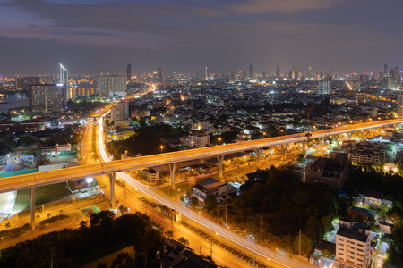 Night view of highway in Bangkok City downtown cityscape urban skyline Thailand Imagens
