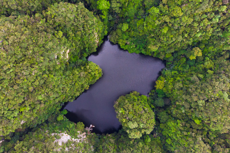 Drone view of lake where is called as mirror lake in Ipoh, Malaysia Imagens