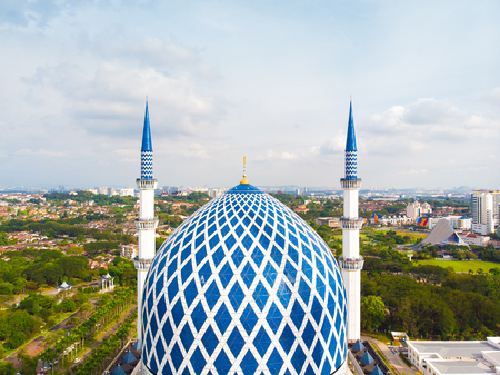Drone view of Masjid Sultan Salahuddin Abdul Aziz Shah or Blue Mosque in Shah alam ,Selangor, Kuala lumpur, Malaysia. Sultan Salahuddin Abdul Aziz Mosque is the biggest mosque in Malaysia.