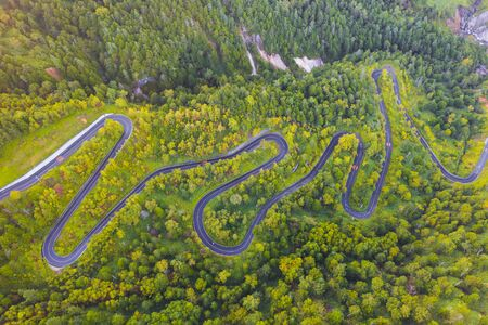 Aerial view of winding road on mountain in Autumn Stok Fotoğraf