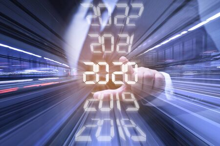 New year combined futuristic concept, Businessman pointing at year 2020