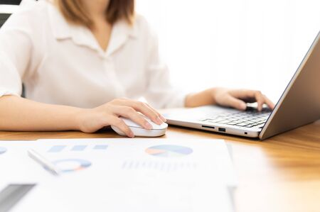 Young woman sale person analzing sale report on desk working at home