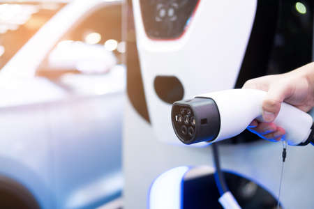 Electric vehicle charging port plugging in EV modern car. save ecology alternative energy sustainable of future Imagens