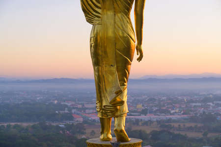 Gold Buddha statue the landmark of Nan province Thailand in Wat Phrathat Khao Noi temple in morning