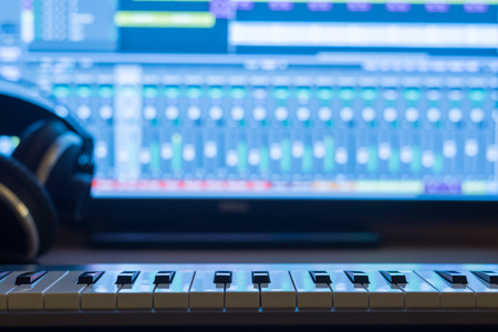 music production: Music production at night. With keyboard and headphones. Stock Photo