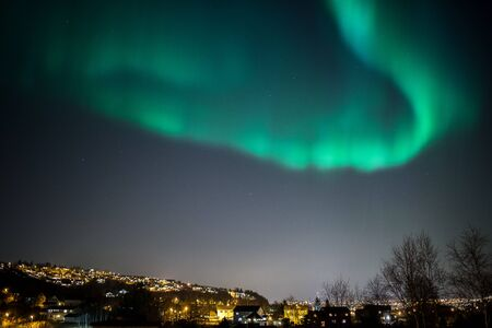 ionosphere: True geomagnetic storm in Norway, cityscape of Trondheim. Stock Photo
