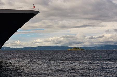ship bow: View of Munkholmen, Trondheim, Norway with a cruise ship bow. Stock Photo