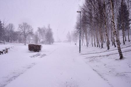 heavily: Snowing heavily in a Norwegian neighborhood covering the walkway