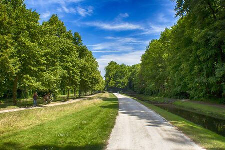 chantilly: This is a lone path leading out of the gardens of Chantilly Stock Photo