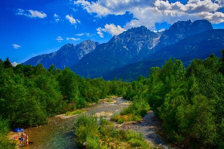A river runs through the Dolomites in Austria Stock Photo