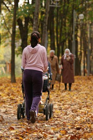 perambulator: Young woman walking with a  Stock Photo