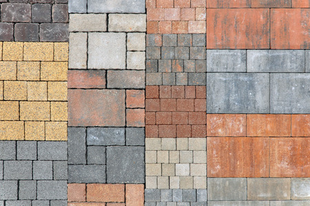 construction materials: Urban background. Samples of rectangular pavement tiles of black, orange, yellow, red, gray. Stock Photo