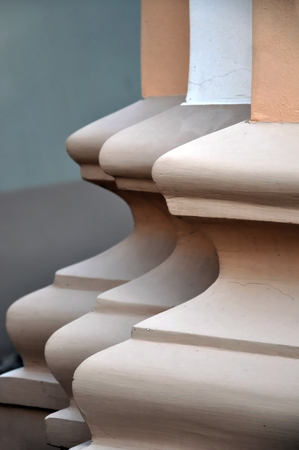identical: Three identical columns in the classical style behind each other.