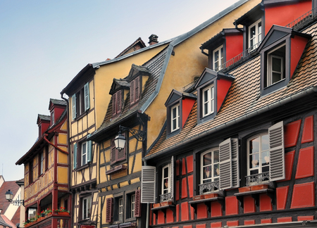 pitched: Pitched roof with skylight of old half-timbered houses of different colors. Colmar, Alsace, France.