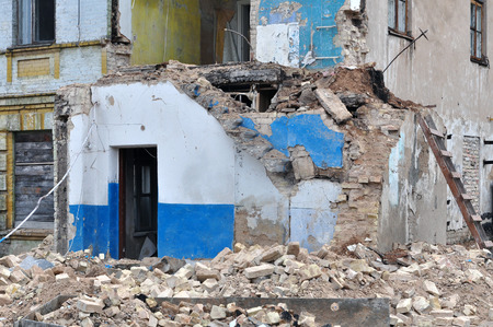 bombardment: Process of demolition of a residential building. Ruined walls, bricks in the foreground. Theme of war, refugees, destruction and reconstruction.